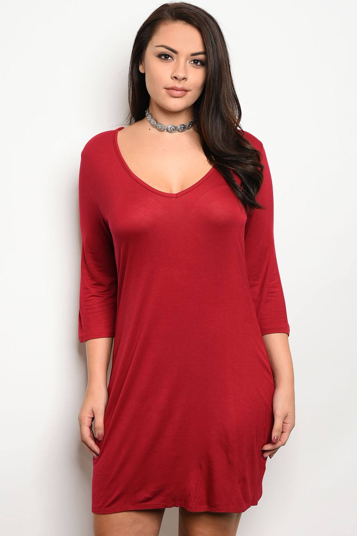 Ladies fashion plus size relaxed fit jersey knee length dress that features a v neckline