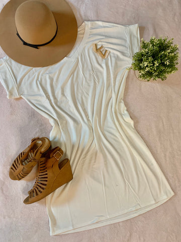 White dress with brown hat