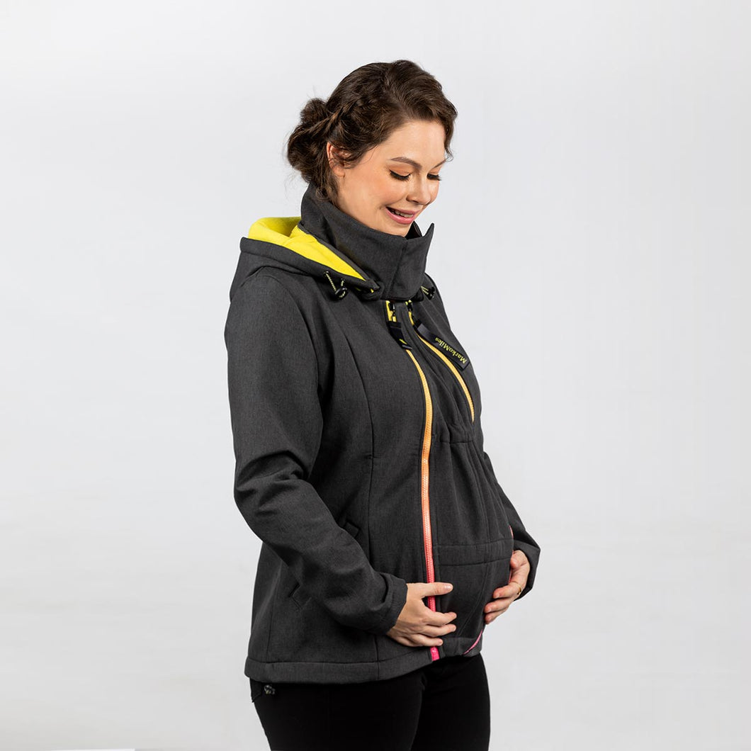 Woman wearing a dark grey babywearing and maternity coat while pregnant.