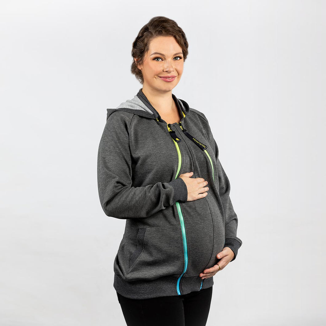 Woman wearing a dark grey babywearing and maternity hoodie while pregnant.