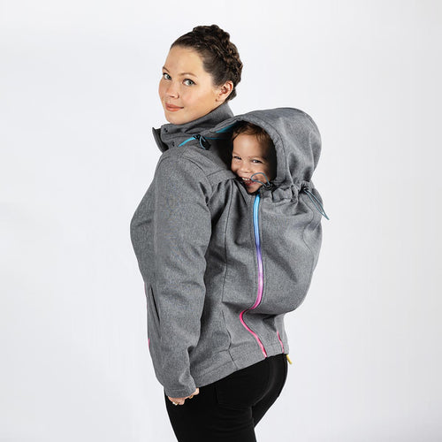 Woman wearing a light grey babywearing and maternity coat while back carrying a small child.