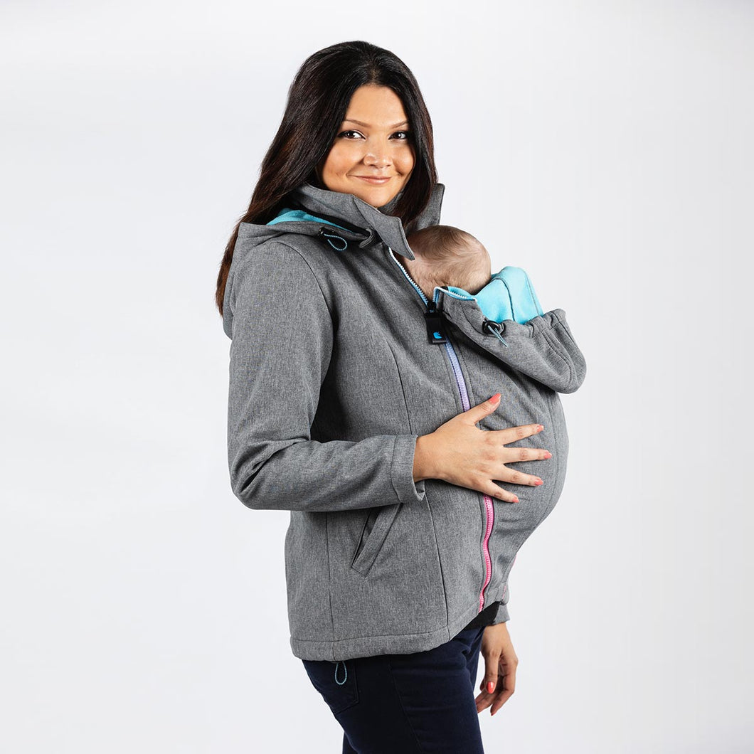 Woman wearing a light grey babywearing and maternity coat while front carrying a small child.