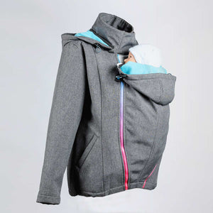 Side image of a light grey babywearing and maternity coat with an infant being front carried.