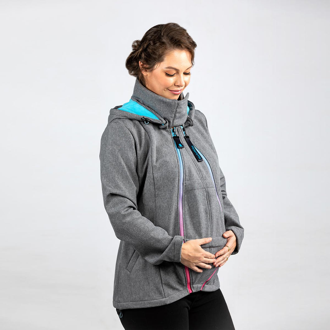 Woman wearing a light grey babywearing and maternity coat while pregnant.
