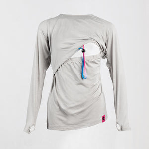 Front image of a light grey long sleeve breastfeeding top with the opening exposing the woman's chest area.