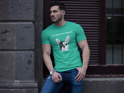 Man wearing a green t-shirt with black and white french bulldog on the front