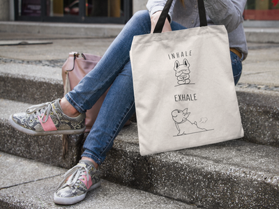 woman sitting on steps holding a Beige tote bag with two french bulldogs doing yoga on, black handle