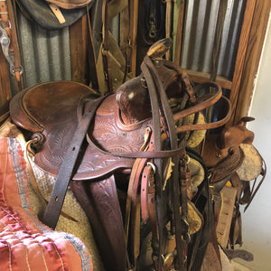 West Texas Saddle Leather Products -  a saddle in a tack room.