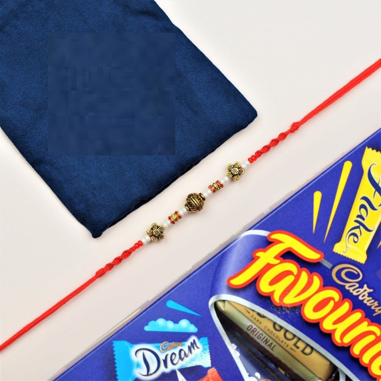 Decent Brass & White Bead Rakhi with Chocolates - FOR NEW ZEALAND