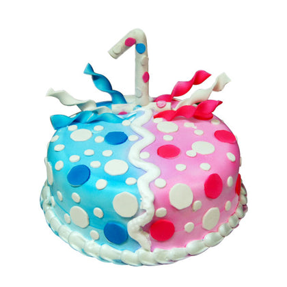 A 1st birthday celebration cake with two color half is blue and half is pink with small white circles perfect for 1st birthday celebration- Expressluv.in