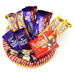 a basket full of chocolates with a variety of chocolates, 13 yummy chocolates with chocolaty delight - Expressluv.in