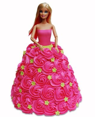 pink color doll cake with pink flowers and green designs on flowers - Expressluv.in