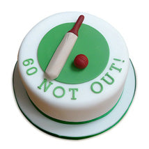 60 Not Out Cake of round shaped of white color and green color design with a bay and red color ball  - Expressluv.in