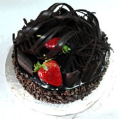 Black Chocolate cake with a round shape and strawberry in the top of the cake - Expressluv.in