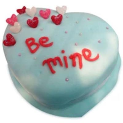 a white color heart shaped cake with some multi color hearts and red color beautiful fonts in the cake - Expressluv.in