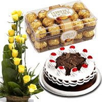 Beautiful anniversary combo of 3 with a yummy round cake, a yellow flowers bouquet and a chocolates box  - Expressluv.in