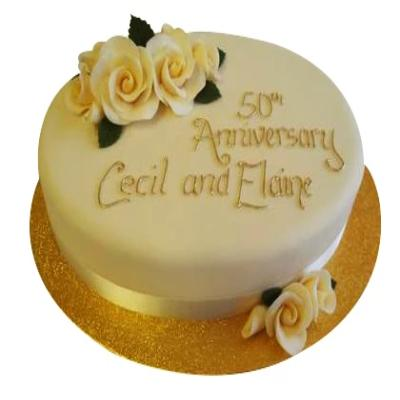 beautiful 50th Anniversary round shaped Cake of cream color with some yellow flower design on it  - Expressluv.in