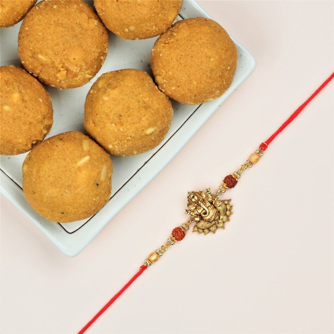 Divine Ganesha Rakhi with Besan Laddu - FOR NEW ZEALAND