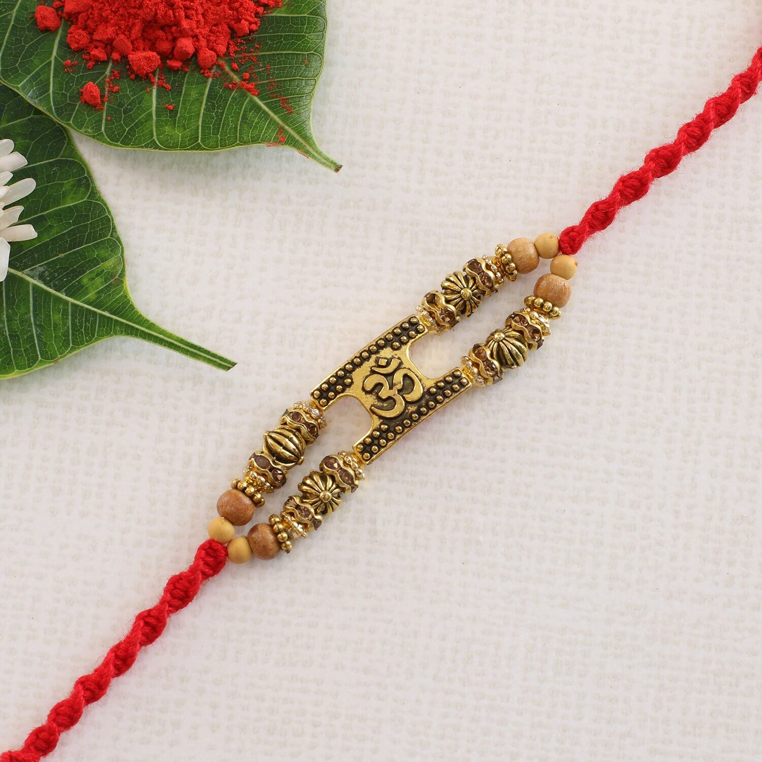 Auspicious Aum Crafted Rakhi  To Europe