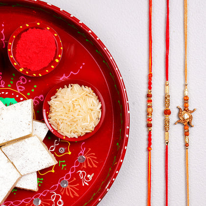Three Rakhi Set with Puja Thali & Kaju Katli Sweet To UK