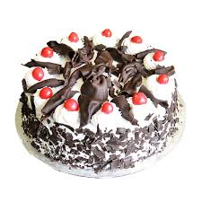 yummy Black Forest Cake 500 Grams round shaped with chocolate chips over the cake - Expressluv.in