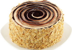 Almond Crunch Cake of round shaped almond crush with chocolate cake - Expressluv.in