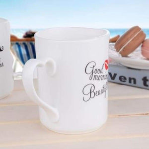 Kissing His and Her Coffee Mugs - kitchen