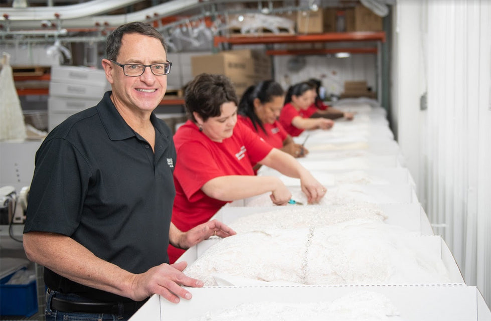 A team that specializes in wedding gown preservation
