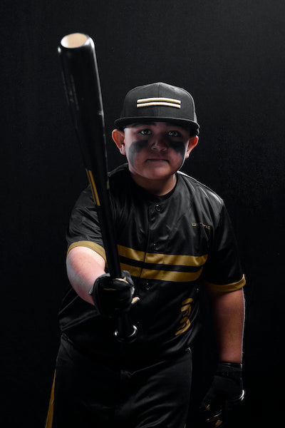 Johnny about to take a swing with a Warstic WSIK58Y Wood Bat