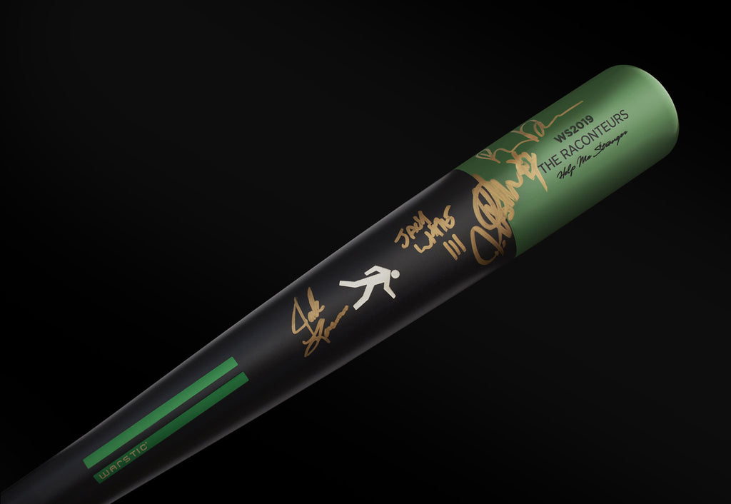 Close up view of the gold autographs on the Raconteurs Special Edition Bat