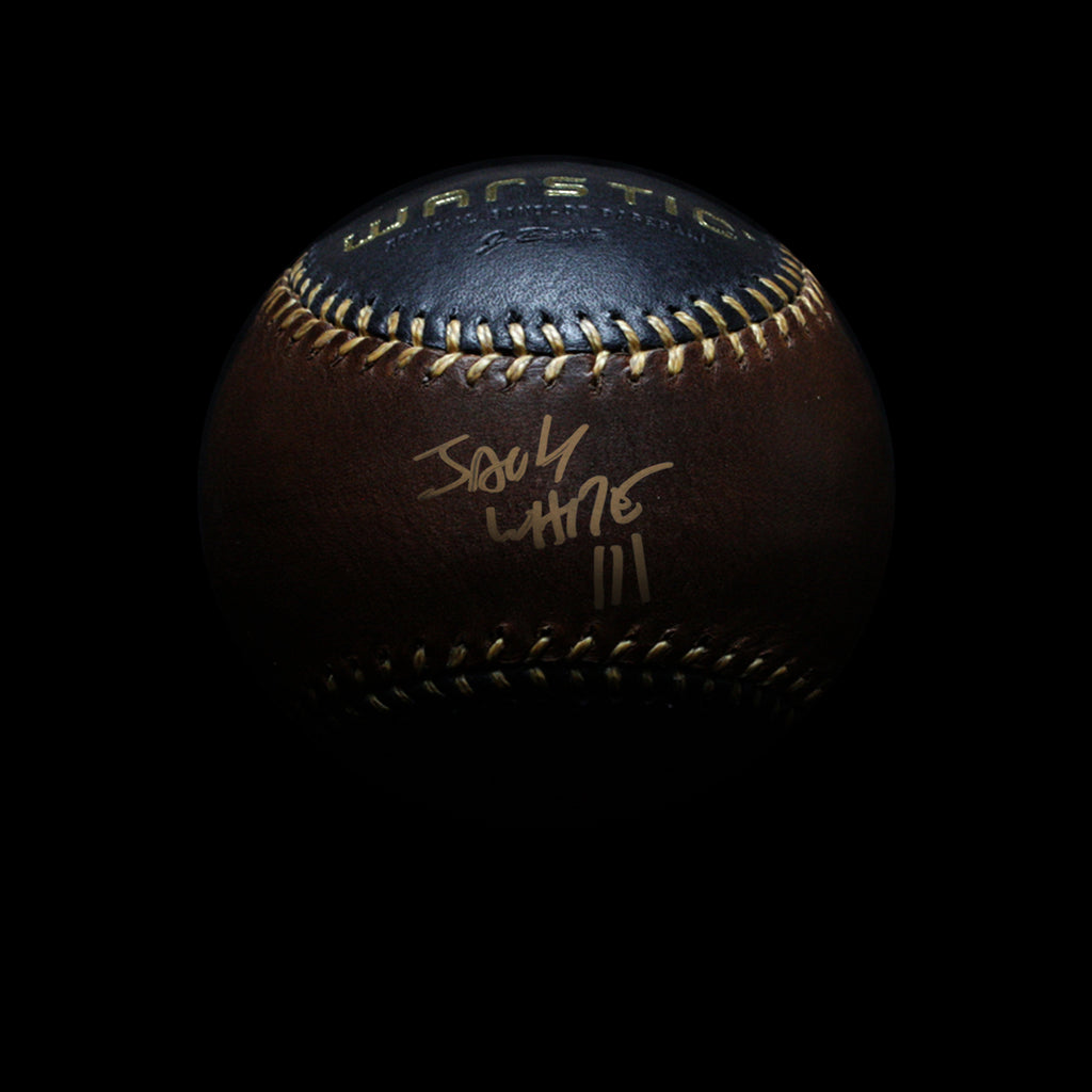 Black and brown leather baseball autographed in gold by Jack White.