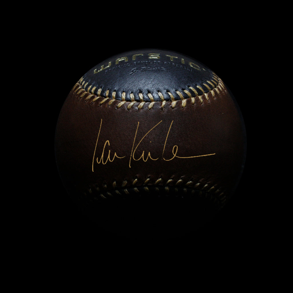 Black and brown leather baseball autographed by Ian Kinsler in gold.