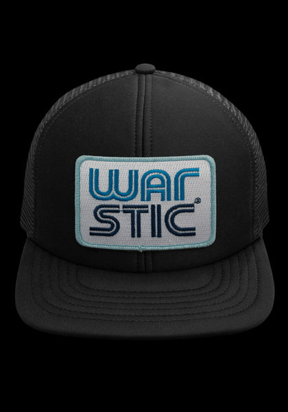 "Front of black trucker style hat with white patch that says ""Warstic"" in royal blue and navy."