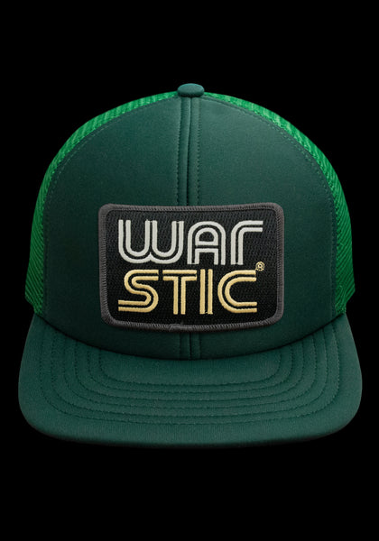 "Front of green trucker style hat with black patch that says ""Warstic"" in white and gold."