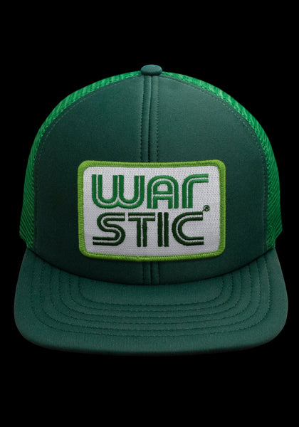 "Front of green trucker style hat with white patch that says ""Warstic"" in grass green and forest green."