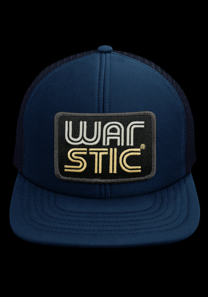 "Front of navy trucker style hat with black patch that says ""Warstic"" in white and gold."
