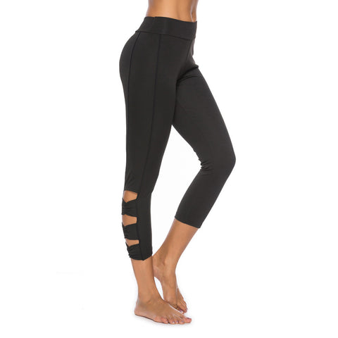 Black hi-rise legging with a side crisscross strap cutout
