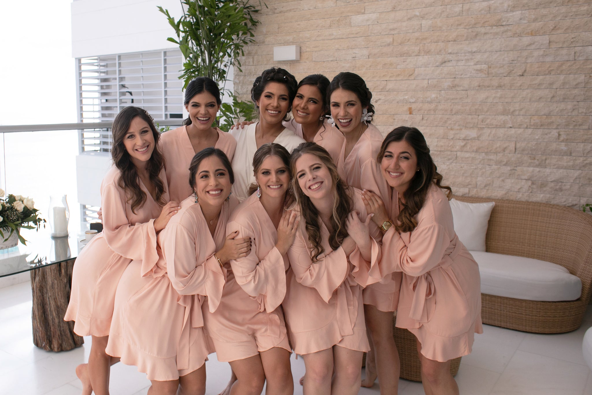 The bride with her bridesmaids in their sustainably made Ruffle Robes by Half Asleep