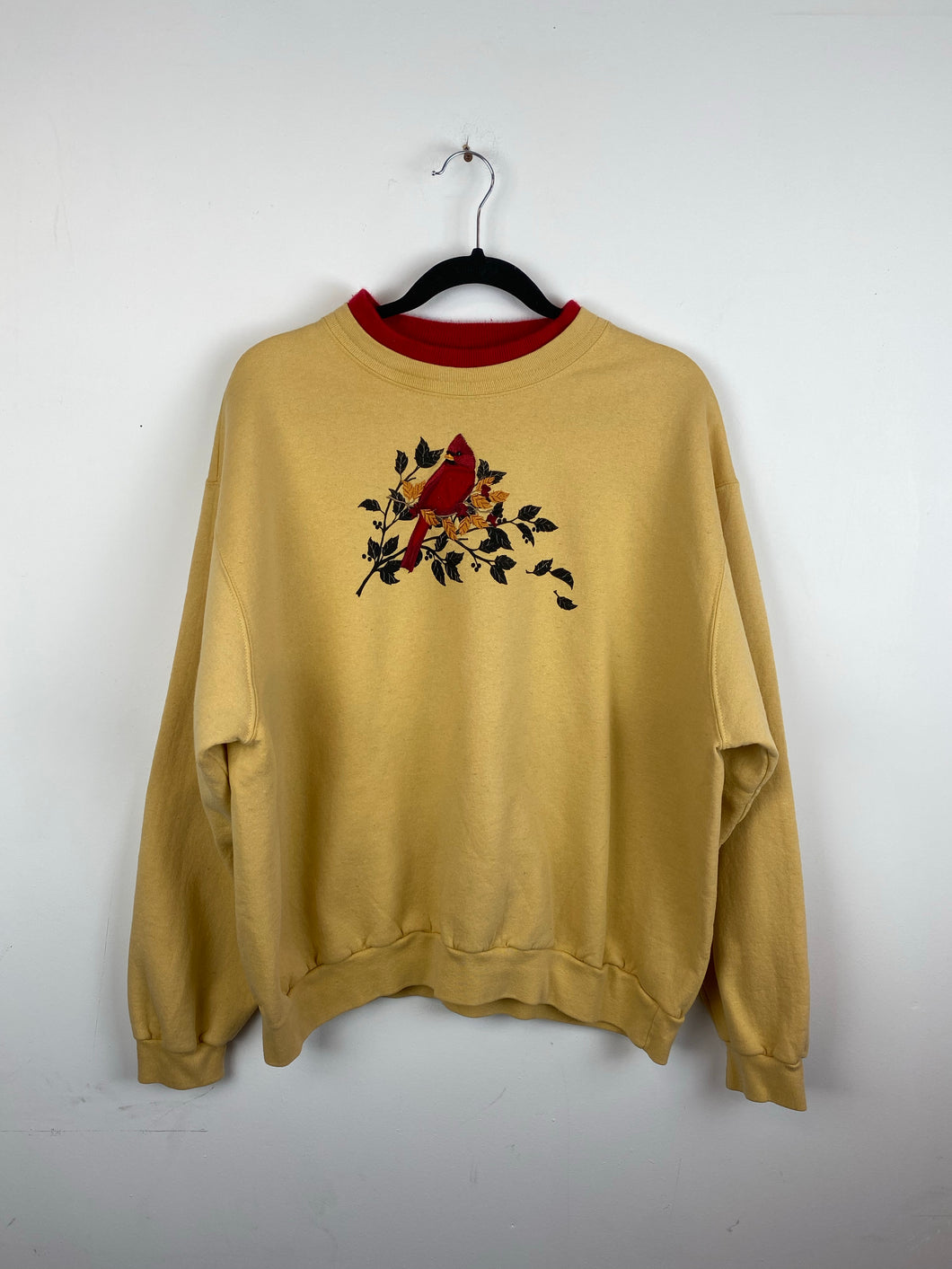 Embroidered bird crewneck
