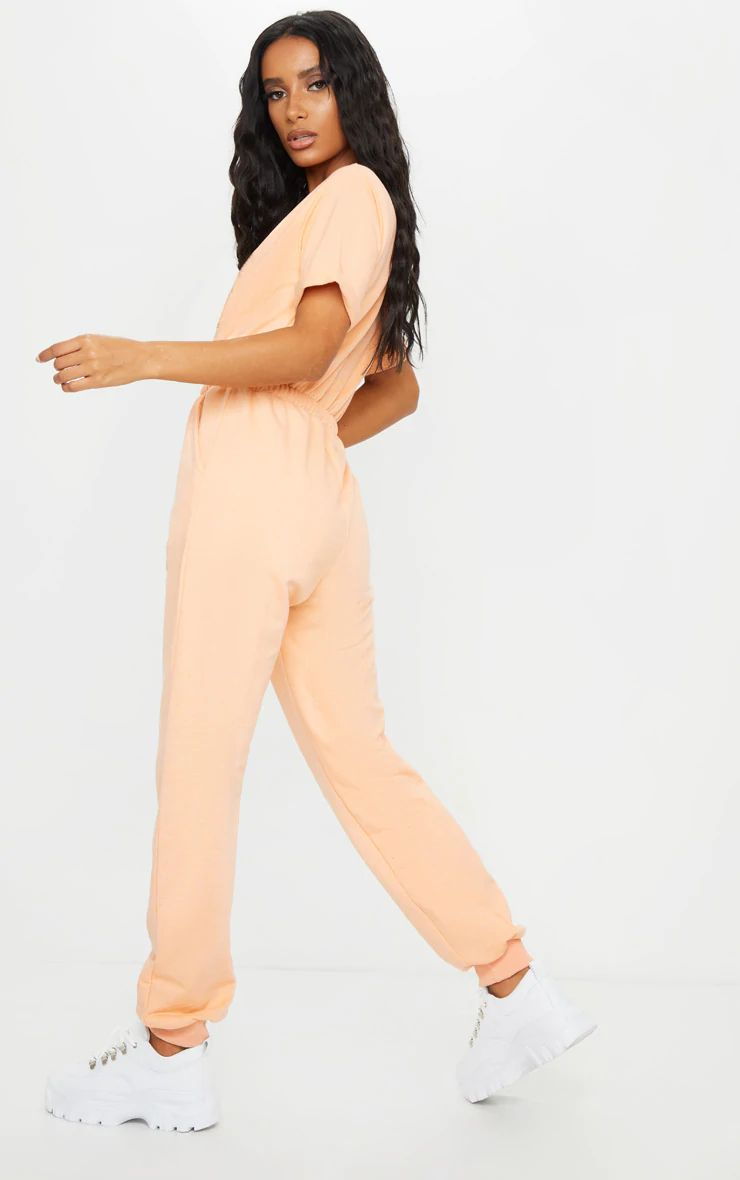 LT.ORANGE SHORT SLEEVE SWEAT JUMPSUIT
