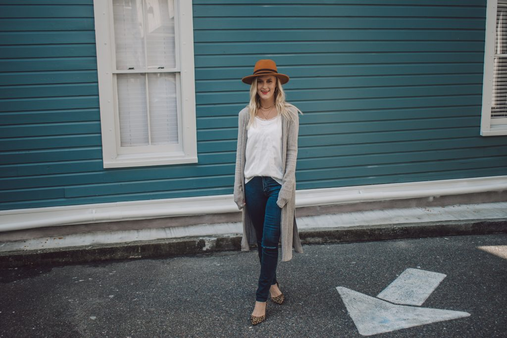 A stylish and fashionable outfit for tall girls, including extra long skinny jeans and a duster cardigan.