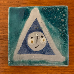 Small tile (Blue face 1) by Roger Capron