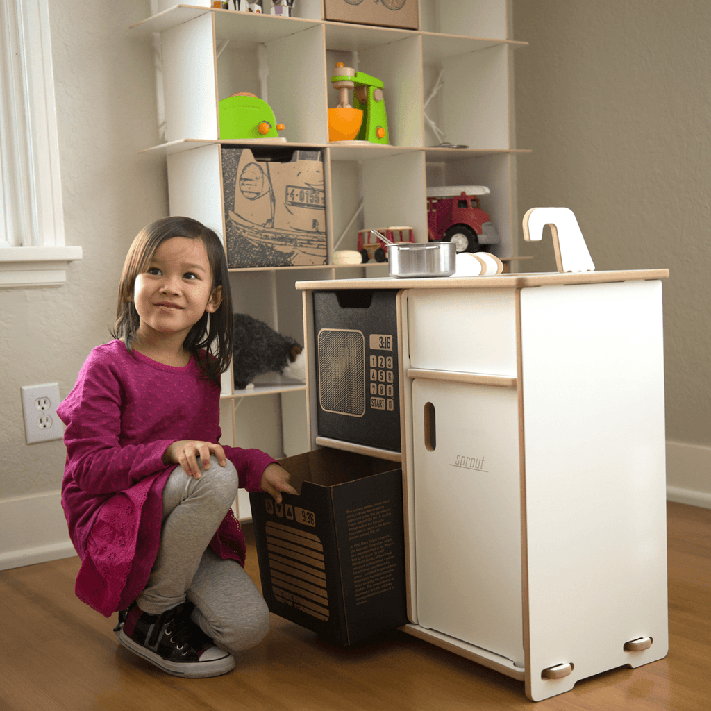 Girl using kitchen bins