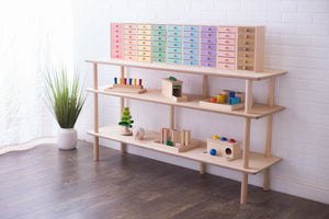 Open Wood Shelves for the Montessori Home or Classroom -- Here seen with an array of toys on the first two levels with multicolored organizing bins up top.