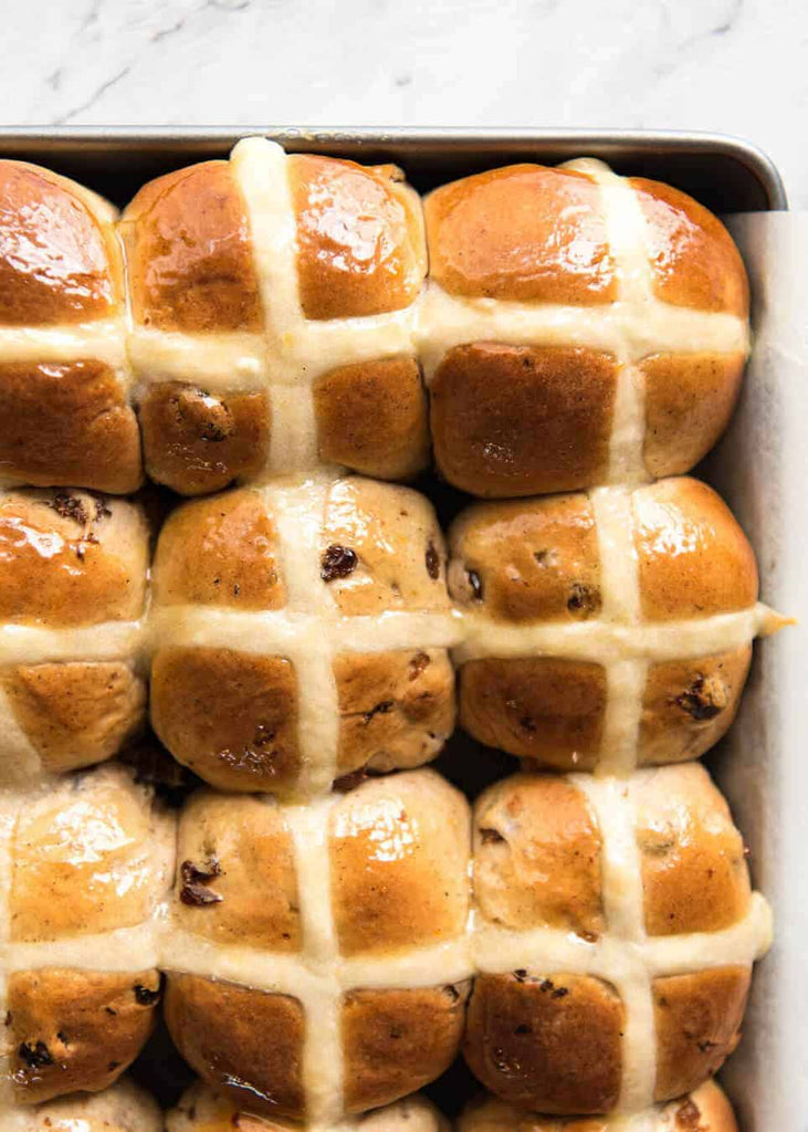 Fluffy, fragrant, homemade Hot Cross Buns recipe! With a short recipe video and some cheeky but effective tips, I think you'll be amazed how easy it is to make hot cross buns.
