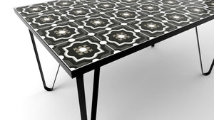 Ceramic tiled dining table with black legs and white fillings
