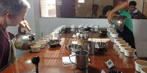 Cupping coffee with our growers in a recent trip to Peru