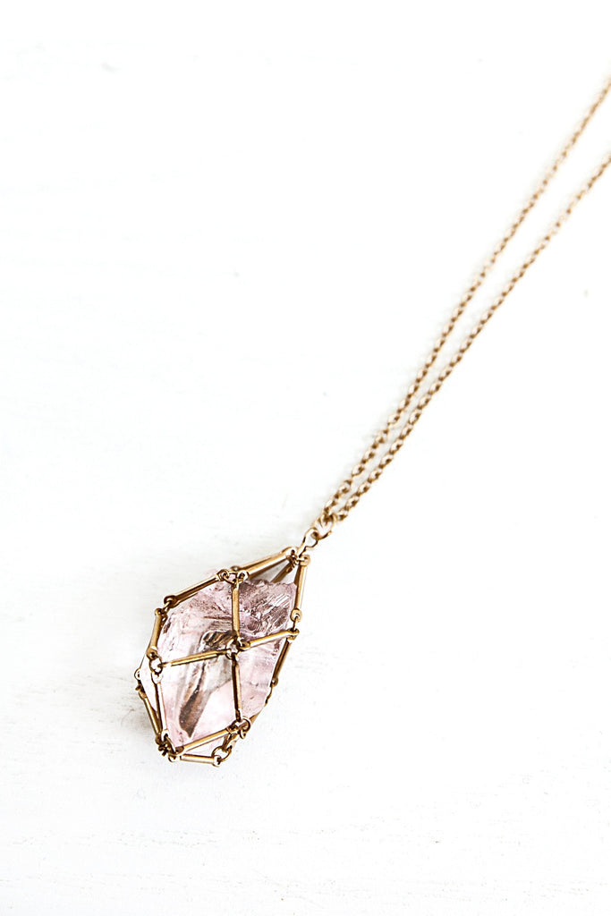 Enclosed Earth Crystal Pendant Necklace