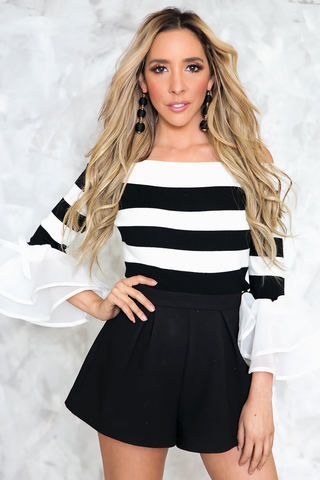 BLAKC AND WHITE STRIPE OFF-SHOULDER TOP WITH RUFFLE AND BOW DETAILING ONT THE SLEEVES