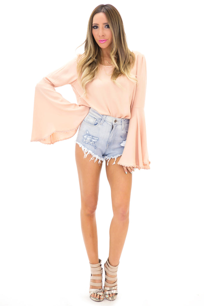 RIPPED LIGHT WASH DENIM SHORTS